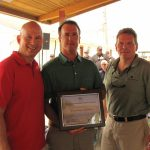 Hank Draper accepting award from Governor Markell and DNREC Secretary, David Small at Delaware State Fair.
