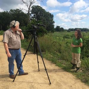 Mike Polo films Alison Rogerson in a Wetland 101 video on salt marsh migration for the DNREC You Tube channel.