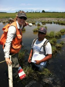 Former seasonal hires Megan Furman and Matt King completing an assessment in a tidal wetland in 2012.