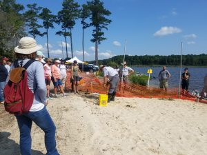 Volunteers receiving instructions on how to plant in a living shoreline.