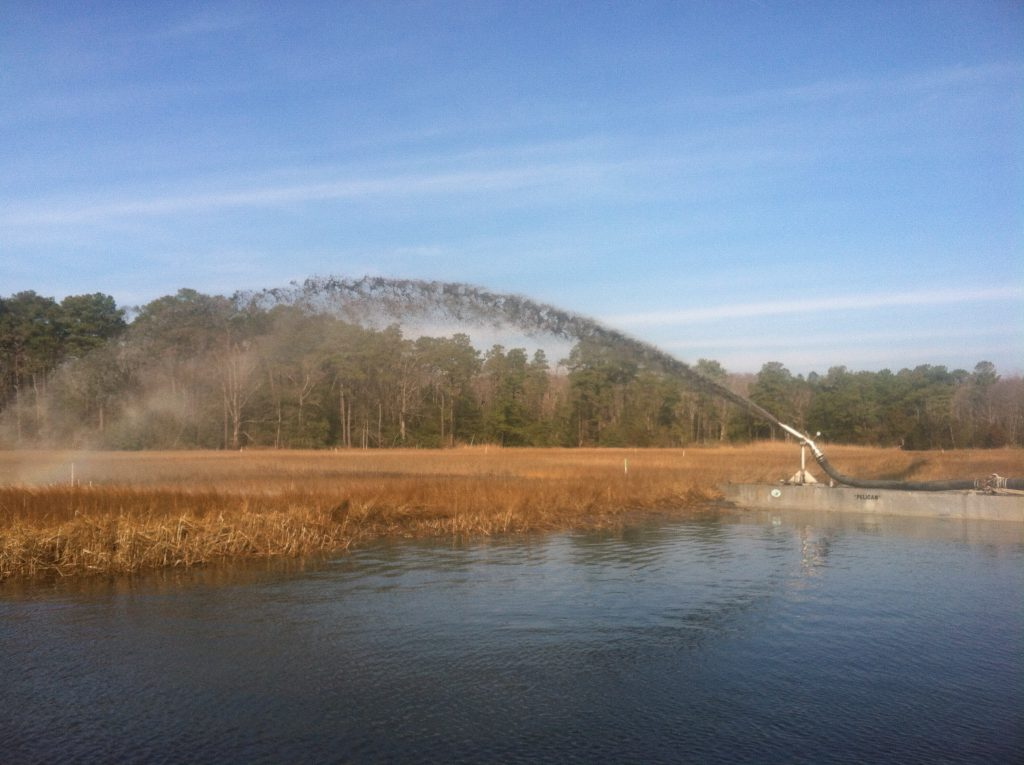Spraying dredge material on the marsh at Piney Point for a beneficial use project. (Photo: DNREC WMAP)