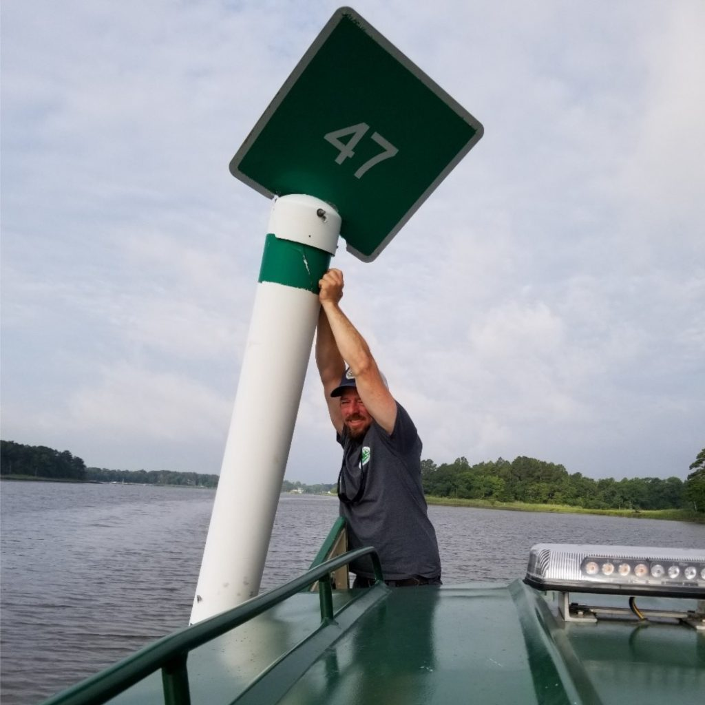 Maintenance work on a channel marker (Photo: DNREC Shoreline & Management Section)